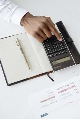 a business plan writer in Canada doing calculations